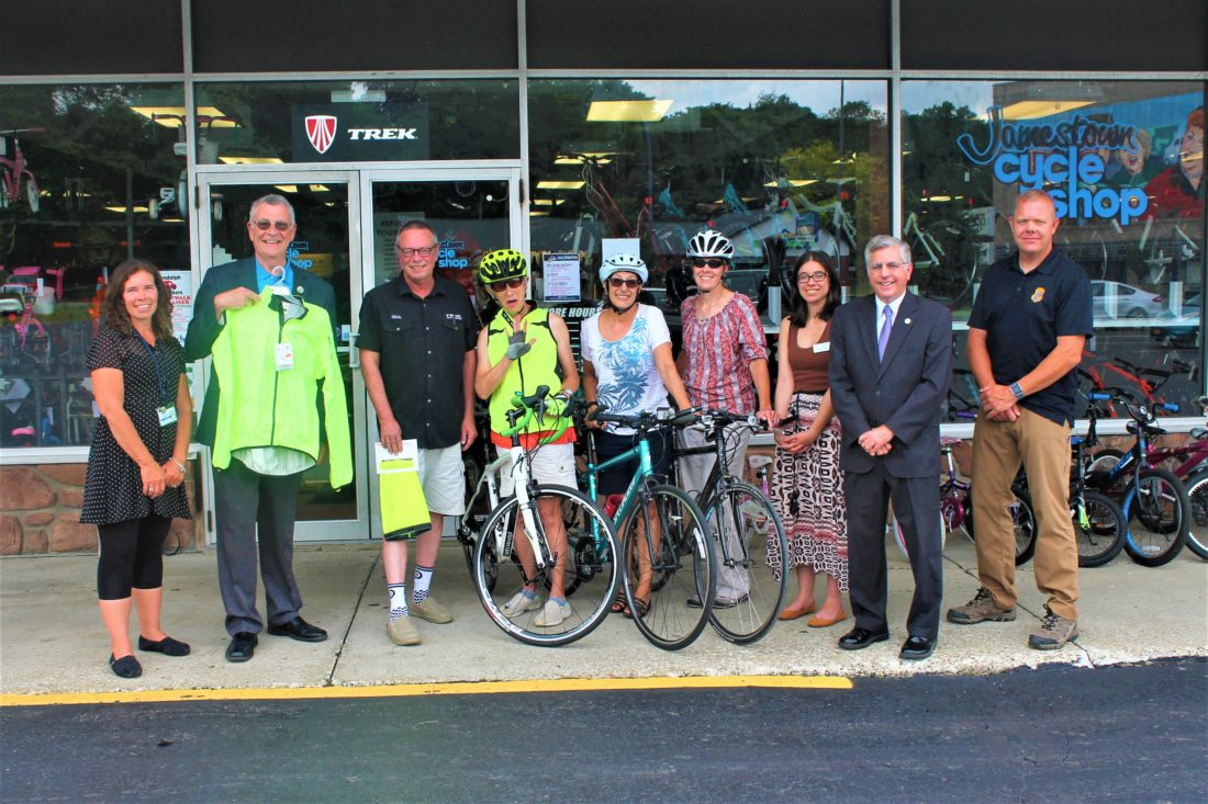 Pictured from left are: Shelly Wells of the Chautauqua County Department of Health and Human Services; County Executive Vince Horrigan; manager of Jamestown Cycle Shop Mike Donner; Members of Women on Wheels Lisa Schmidtfrerick-Miller and Linnea Carlson; Jamestown Mayor Sam Teresi; and Capt. Robert Samuelson of the Jamestown Police Department.