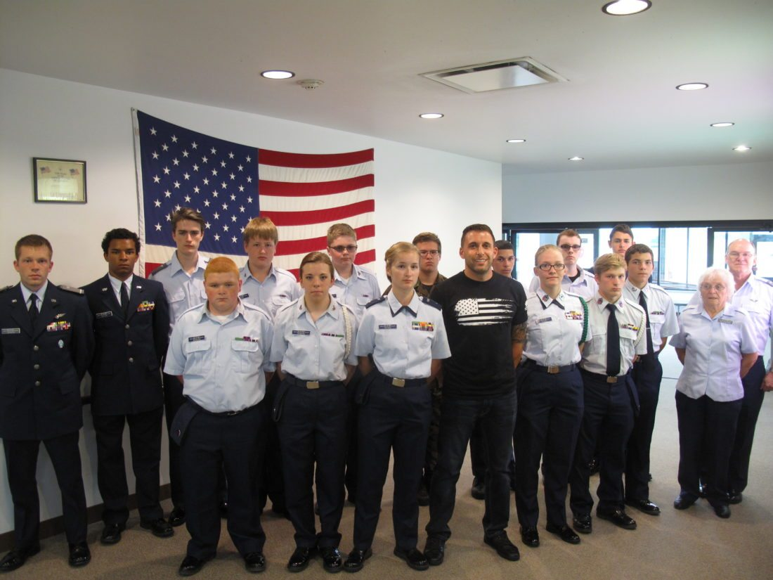 Jamestown native and Air Force Staff Sgt. Kyle Baglia, in center, spoke to cadets of the Civil Air Patrol Jamestown Composite Squadron 402 at the Chautauqua County-Jamestown Airport on Thursday. Baglia is a former cadet of the Civil Air Patrol and is a member of the Thunderbirds, the U.S. Air Force Air Demonstration Squadron. P-J photo by A.J. Rao