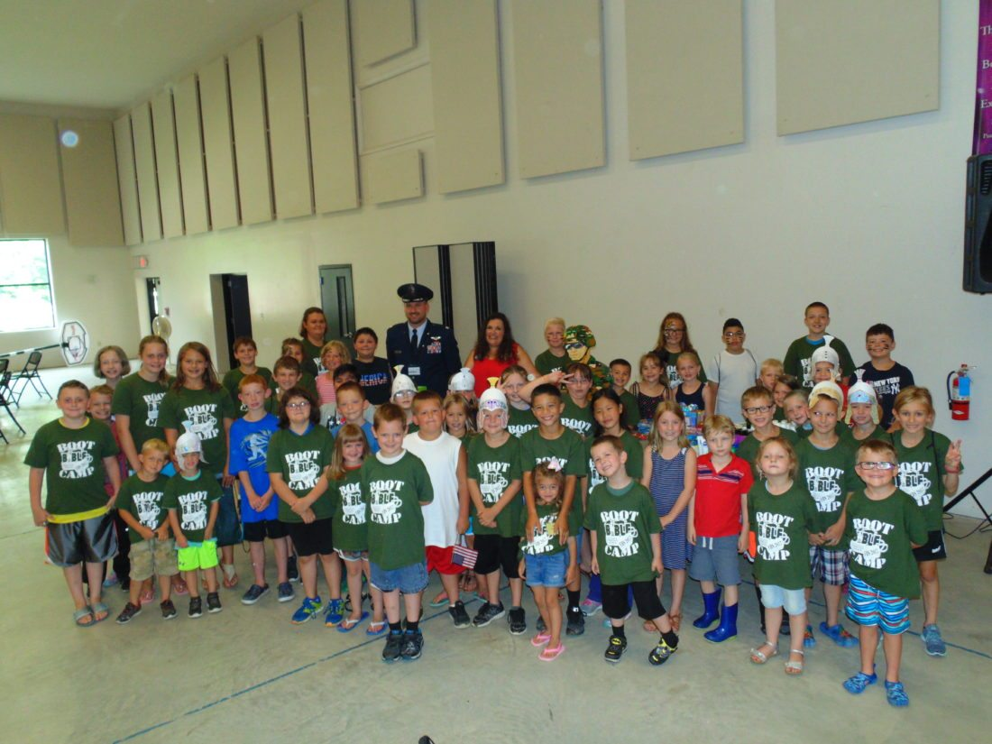 "In a show of support for service men and women, Fluvanna Community Church's ""Bible Boot Camp"" participants donated an array of goods and a $441 check to Blue Star Mothers on Friday. Pictured are the children who participated in ""Bible Boot Camp"" along with Susan Rowley, Blue Star Mothers Chapter 4 president, and Gregory Carlson, retired Major of the U.S. Air Force and current director of the Chautauqua County Veterans Service Agency.  P-J photos by Jimmy McCarthy"