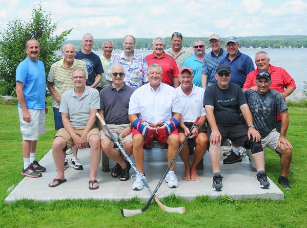 Above are the members of the Jamestown All-Americans, a hockey team, which first took the ice for the 1976-77 season and continued play through the early 1980s. Celebrating a 40th reunion at the Lakewood Community Park and Launch on Sunday are, seated from the left, Paul Demler, Gene Warner, Jeff Hutchinson, Jeff Lindell, Dave Frattalone and Larry Anderson. Standing are Joe Gerace, Len Powell, Mark Spang, Greg Whitermore, Dan Akam, Tom Prohaska, Jim Cheney, Bill Dempsey, Joe Johnson, Jackie Evan and John Dunderdale. P-J photo by Scott Kindberg