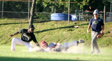 Mayville's Chris Williams applies a tag on Noah Johnson during 16-18-year-old Babe Ruth action Tuesday evening at Roseland Park in Jamestown.  P-J photos by Cody Crandall