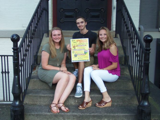 Bemus Point teens Allyssa Seeley, Cameron Rowe and Taylor Samuelson are gearing up for the second annual Change For Chihopi yard sale fundraiser for Camp Chihopi. This year, the event will not only feature a yard sale, but also a pulled pork dinner and a basket auction.  P-J photo by Katrina Fuller