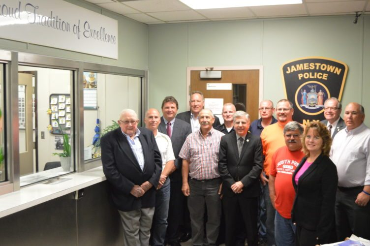 Pictured, from left, are Joe Edwards Jr., Chautauqua Patrons Insurance Company Board of Directors member;  Rich Panebianco, D&S Glass; Mike Roberts, Allied Alarm Services, Inc. president; Tim Shults, Shults Auto Group president; Mike LaTone, D & S Glass owner; Harry Snellings, Jamestown Police Department chief; Sam Teresi, Jamestown mayor; Troy Barber, Dawson Doors engineer; Chris Lynn, Lynn Development Group; Todd Propheter, Jamestown building superintendent; Brenda Henderson, Dawson Metal Company Inc., executive administrator; Randy Sweeney, Chautauqua Region Community Foundation executive director; Jeff Lehman, Jamestown director of public works. Submitted photo