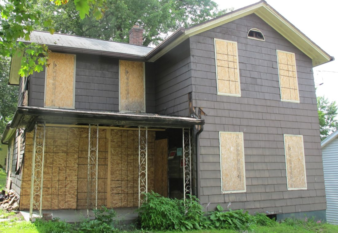 A boarded up substandard house on Spring Street in Jamestown. Substandard housing is one issue the city's Development Department is trying to battle in the city. P-J photo by Dennis Phillips