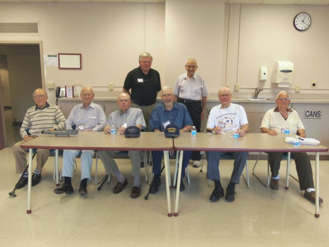 Several area World War II veterans came together Saturday to share their experiences during the war at Scharmann Theatre during Fenton History Center's Local World War II Veteran Panel. Pictured from left are Doug Benson, Paul Arnone, Bill Graves, Winston Frankson, Roland Swanson and Arthur Hodges. In the back, from left, are Greg Peterson and Tom Tedesco.  P-J photo by Katrina Fuller