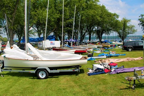 Thistle Boats lined up at Mayville's Lakeside Park on Sunday for competitions during the upcoming week. Photo by Jordan Patterson