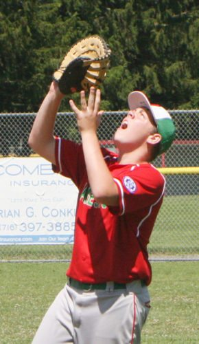 Jamestown All-Stars first baseman Calvin Ricker prepares to catch a popup during the Western New York State Tournament two weeks ago. P-J file photo by Scott Kindberg