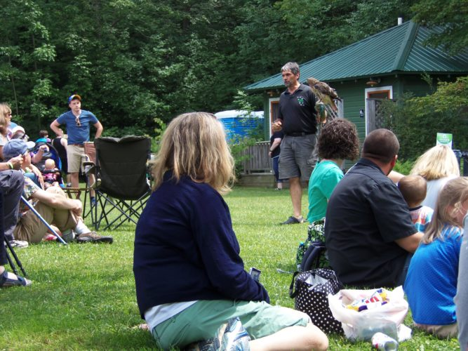 Paul Fehringer, founder of Wild Spirit Education, introduces the crowd to a red-tailed hawk.  P-J photo by Katrina Fuller