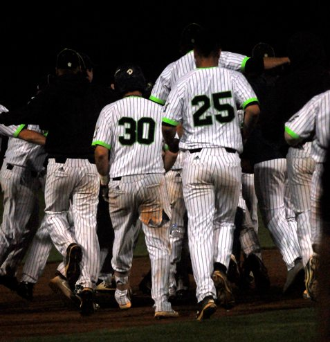Jammers Ben Brookover (30) and Chris Stefl (25) race to join a celebration after the game-winning hit. P-J photos by Matt Spielman