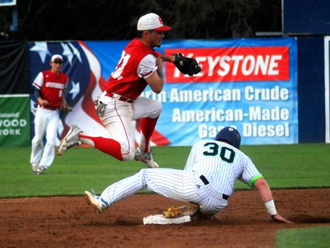 Above, Jamestown's Ben Brookover (30) breaks up a double-play attempt at second base during Tuesday's Perfect Game College Baseball League playoff game. P-J photo by Matt Spielman