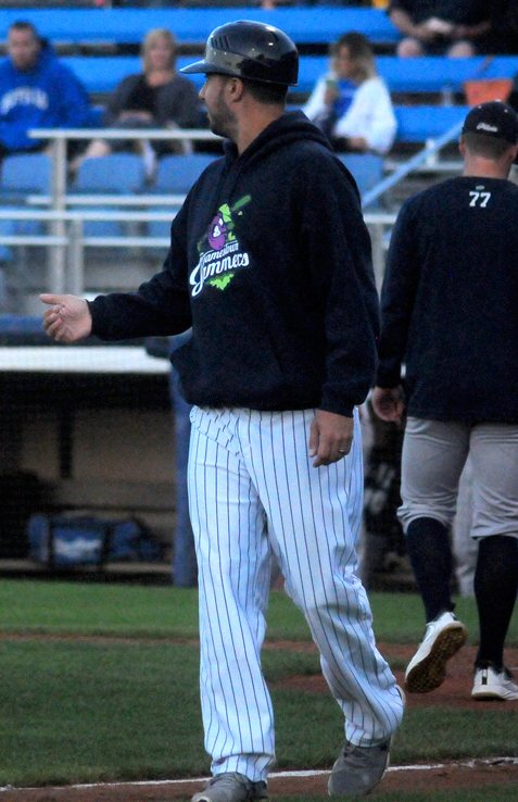 Jamestown Jammers manager Anthony Barone discusses a play with the umpires earlier this season. P-J photo by Matt Spielman