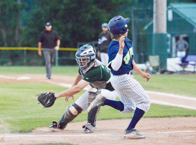 Jamestown's Nick Bernick, right, races past Mohawk Valley catcher Clay Koniencki to score the Jammers' only run in their 11-1 loss to the DiamondDawgs in Game 1 of the Perfect Game Collegiate Baseball League Championship Series at Veterans Memorial Park in Little Falls on Sunday night. P-J photo by Scott Reagle