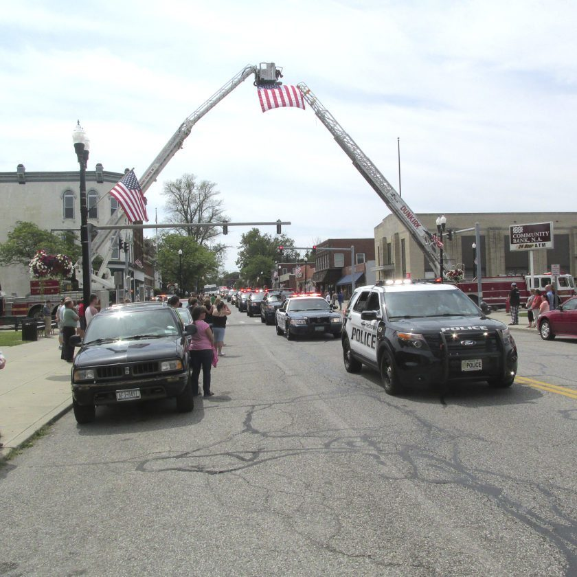 The intersection of Fourth Street and Central Avenue near Dunkirk City Hall with a steady stream of vehicles making up the Procession for Officer Hazelton. The Procession started at Holy Trinity Church and ended at the cemetery in Portland. Photo by Damian Sebouhian