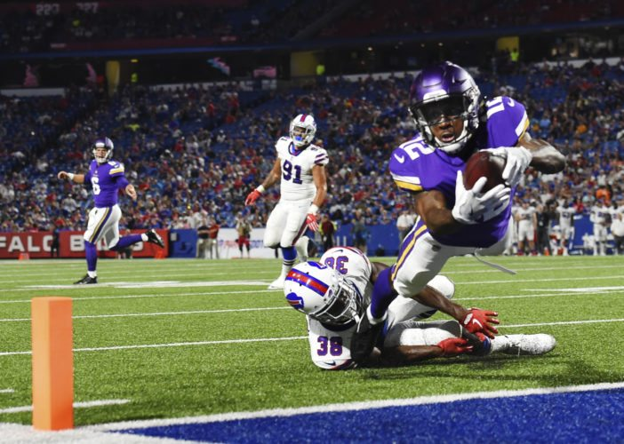 Minnesota Vikings wide receiver Rodney Adams (12) dives away from Buffalo Bills defensive back Charles James (38) for a touchdown during the second half of a preseason NFL football game Thursday, Aug. 10, 2017, in Orchard Park, N.Y. (AP Photo/Rich Barnes)