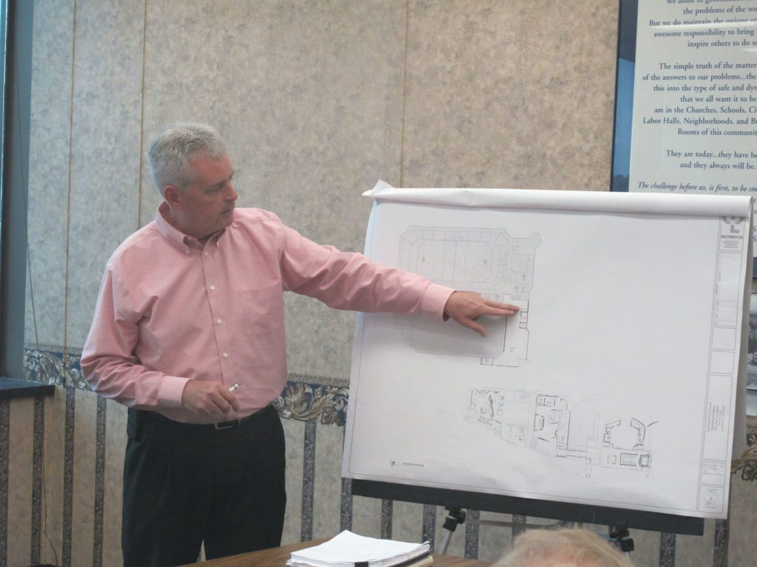 David Leathers goes over the preliminary blueprints for the proposed plan to expand the Northwest Arena. P-J photo by Dennis Phillips