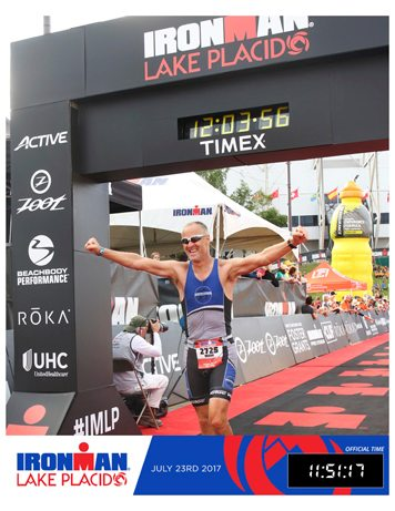 Mark Wilson is all smiles upon completing the Ironman Triathlon in Lake Placid on July 23. The Randolph resident finished in 11:51:17. Submitted photo