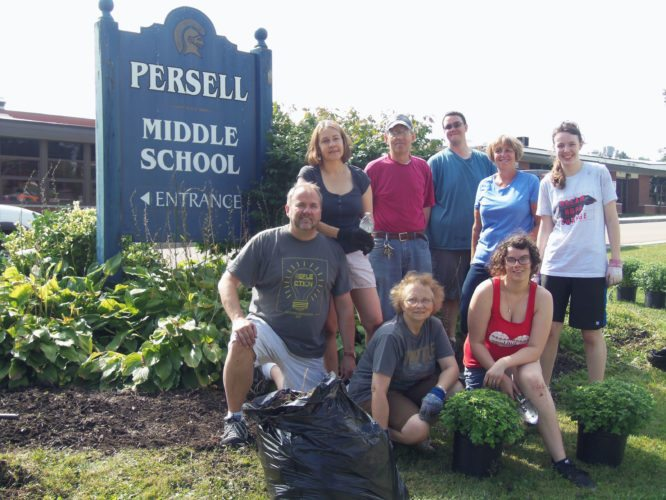 Volunteers helped clean up the flowerbeds and gardens at Persell Middle School and Lincoln Elementary School on Saturday as part of ServJamestown. P-J photo by Katrina Fuller