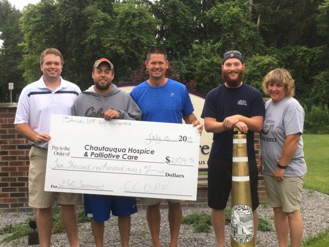 Chautauqua County Department of Public Facilities employees Joey Triscuit, Andy Lata, Steve Sweeney, Corey Card and Kendrya Sheldon with a check for $2,109 which was raised to benefit Chautauqua Hospice and Palliative Care. Submitted photo