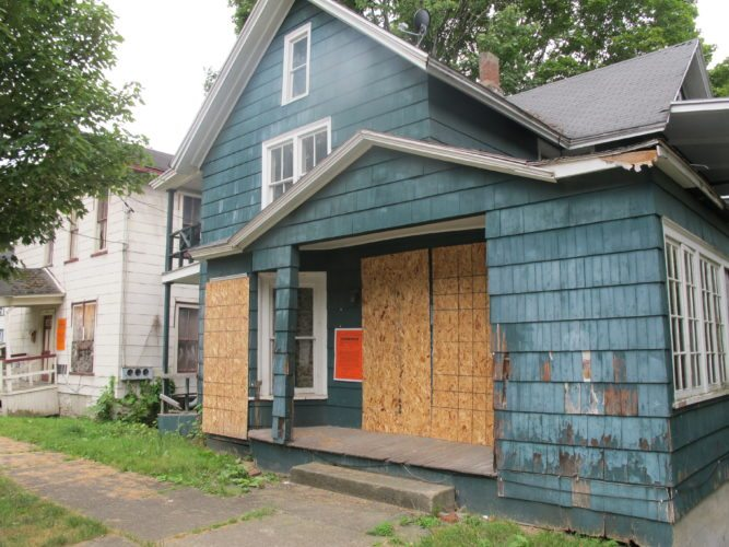 A boarded up house on Spring Street is one of several condemned houses in the city, including the property next door. More than 200 properties in the city have had multiple cases code violation cases opened during the last two years. P-J photo by Dennis Phillips