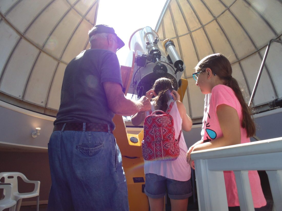 Pictured, from top to bottom: Hundreds came out to the Martz Observatory on Monday to get a glimpse of the solar eclipse. Individuals had the chance to view the eclipse inside and outside the observatory