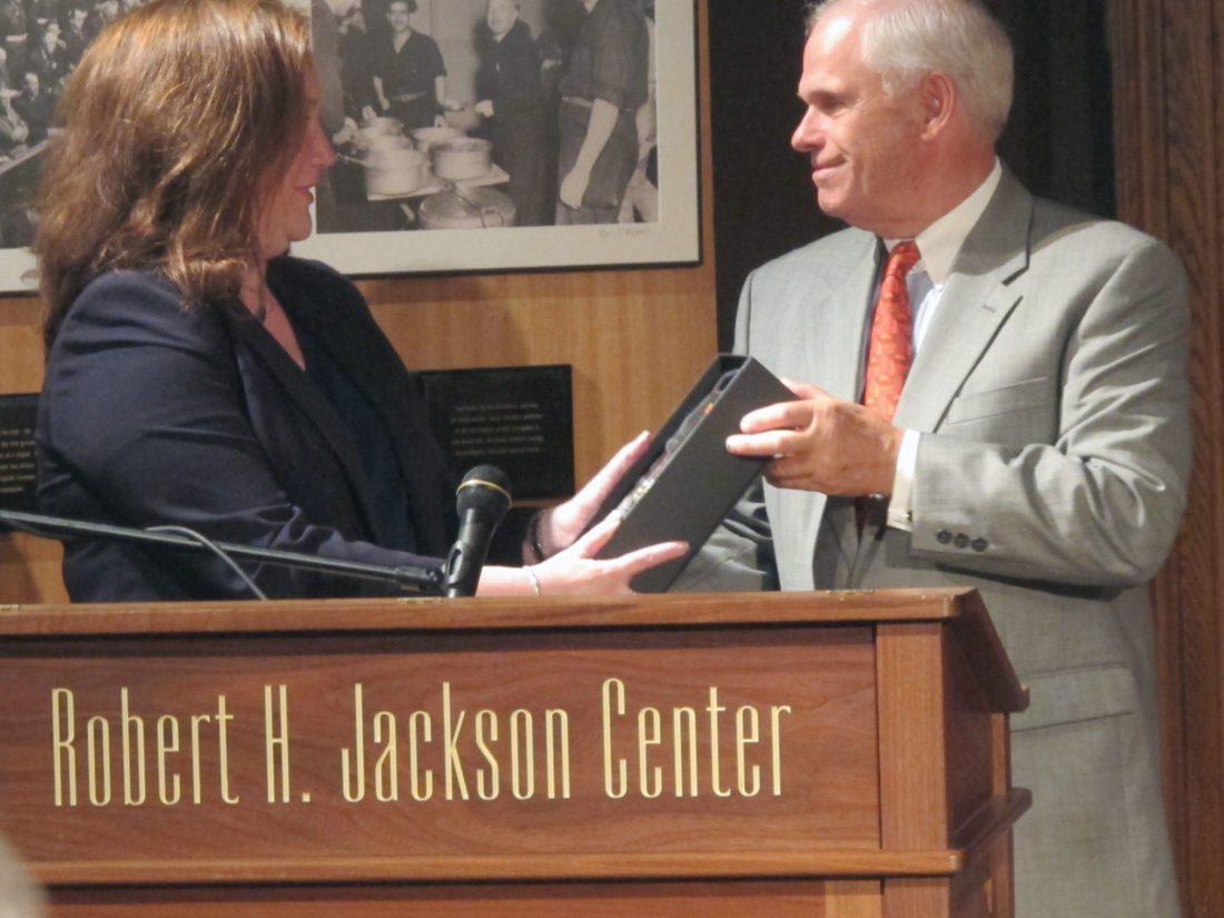 Aviva Abramovsky accepts the Joshua Heintz Award for Humanitarian Achievement for Dr. Zainab Hawa Bangura from Joshua Heintz during the 11th annual International Humanitarian Law Dialogues at the Robert H. Jackson Center on Sunday.