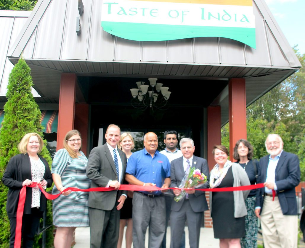The reopening of Taste of India at its new location, 718 W. Third St. in Jamestown, was celebrated with a ribbon-cutting ceremony Thursday. P-J photo by Gavin Paterniti