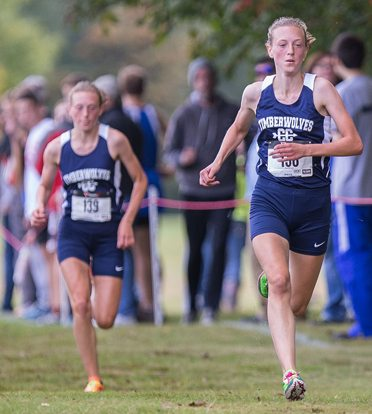 Abby Gostomski leads her sister, Bailey, who finished one-two in the girls Small School race. P-J photo by Tim Frank