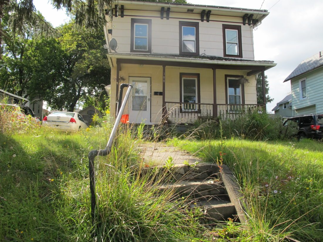 A high grass and weeds housing code violation case opened for this house on South Main Street Sept. 5. P-J photo by Dennis Phillips