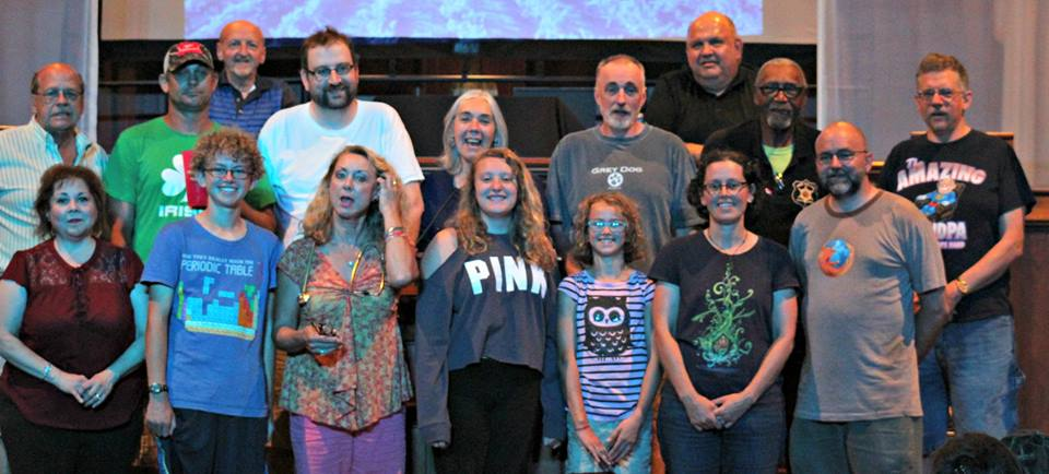 Front Row: Libby Cardy Sciarrino, Isaac Rutter, Carolyn Lunt, Angel Busch, Alix Rutter and Mike Rutter. Second row: Rick Mathews, Demian Seger, Ryan Bennett, Judy Einach, Randy Henderson, Charlie Bryant and John Daily. Top two: Rick Mascaro and Kelly Mathews. Missing from the photo are: Joan Caruso, Laurie Diehl, Barb Johnson and Sue Poster.