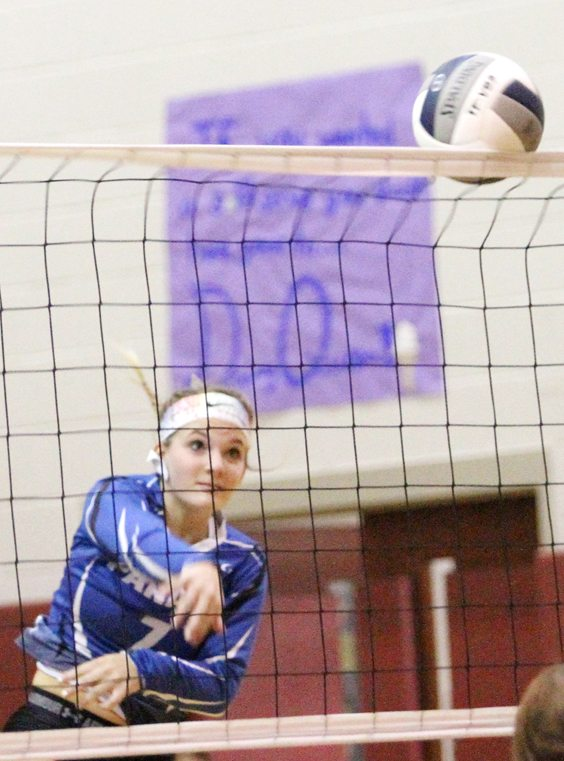 Madalyn Bowen of Panama hits the ball over the net. P-J photo by Lisa Monacelli