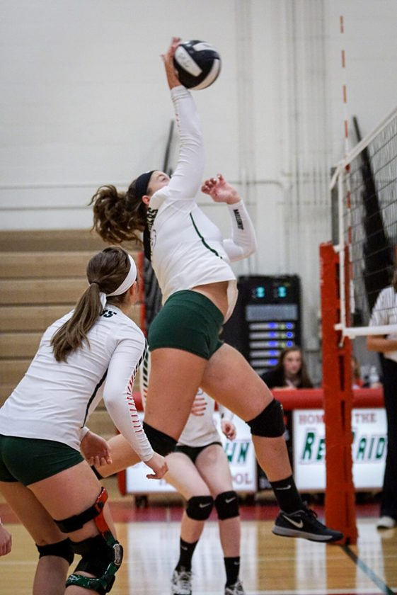 Jamestown's Morgan Tracy spikes the ball over the net during Monday's Erie County Interscholastic Conference Division 1 volleyball match at McElrath Gym. P-J photo by Chad Ecklof