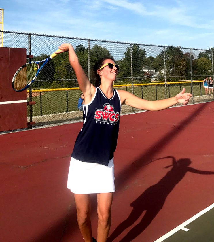 Southwestern's Mikayla Johnson serves an ace during CCAA West Division tennis action Tuesday in Dunkirk. Submitted photo