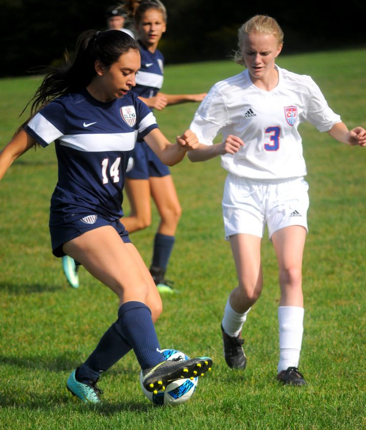 Chautauqua Lake's Katelyn Fardink attempts to control the ball as Cassadaga Valley defender Abigail Little closes in during Tuesday's CCAA Central Division girls soccer game in Sinclairville. P-J Photo by Matt Spielman