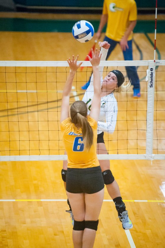 Jamestown CC's Mackenzie Marsh goes up for a spike Tuesday. P-J photo by  Valory S. Isaacson
