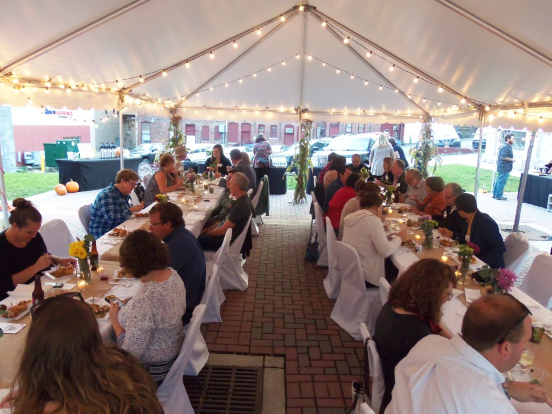 The Winter Garden Plaza in downtown Jamestown hosted the locally focused Market to Table Dinner on Thursday evening, complete with hors d'oeuvres, entrees featuring local fare and desserts.  P-J photo by Katrina Fuller