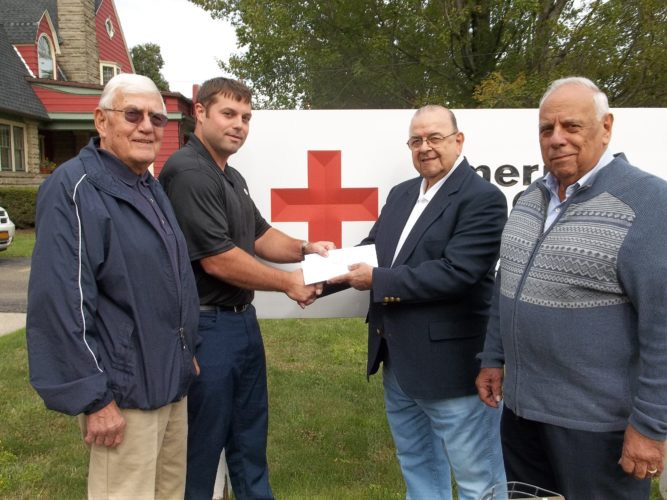 From left are Roger Edborg of the SERTOMA Club, Justin Axelson of the American Red Cross, Cosmo Demaio, SERTOMA Club president, and Tony Raffa, SERTOMA Club chairman. The SERTOMA Club of Jamestown donated $1,000 to the Hurricane Harvey Relief Fund and $300 for Emergency Disaster Services.