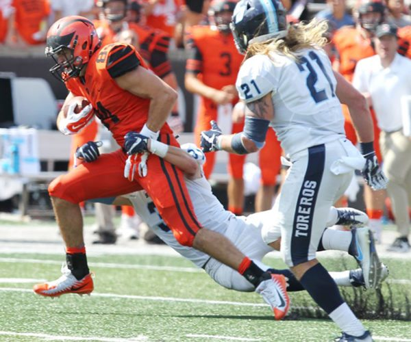 Jamestown High School graduate Stephen Carlson (84) is dragged down from behind after catching one of his six passes in Princeton University's season-opening football victory over San Diego on Saturday afternoon. Of his six receptions, three went for touchdowns. Photo courtesy of Princeton University