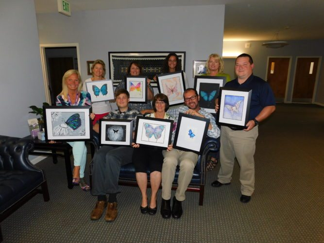 Chautauqua Hospice and Palliative Care Staff is pictured with some of the student artwork that will be featured at the CHPC Charity Auction on Friday, Sept. 29, at Chautauqua Suites in Mayville.