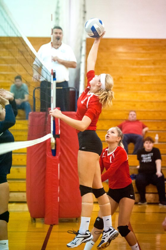 Cassadaga Valley's Jenna Caskey goes above the net to hit the ball while teammate Savannah Nickerson looks on during Monday's non-league volleyball Monday in Sinclairville. P-J photo by Valory S. Isaacson