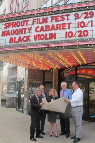 From left, Sam Teresi, Jamestown mayor; Vince DeJoy, city development director; Kathleen Eads, Reg Lenna Center for the Arts executive director; Gregory Rabb, Jamestown City Council president; and Matt Hanley, Reg Lenna Center for the Arts board president; discussing the new LED screen marquee that will be retrofitted to the current signboard next month. The unveiling of the new marquee is scheduled for Friday, Oct. 20, during the street party prior to the Black Violin: Classical Boom Tour performance. P-J photo by Dennis Phillips