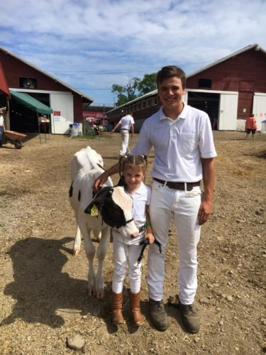 Dexter Ormond from Kennedy is the August 4-H SuperYouth, pictured with DairyBud Ellie Ames at the 2017 Chautauqua County Fair.