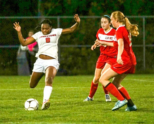 Jamestown's Promyss Williams makes a play in front of two Clarence defenders during Tuesday's ECICDivision 1 girls soccer game at the Martin Road Complex. P-J photo by Chad Ecklof