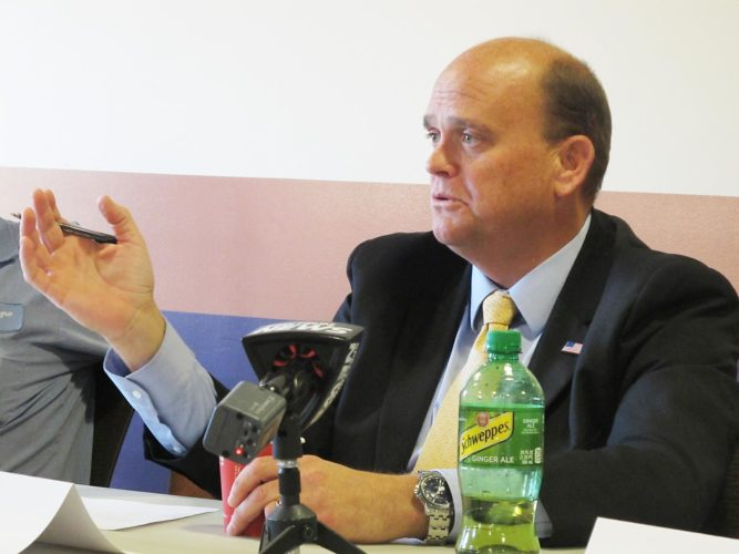 Rep. Tom Reed discusses tax, immigration and trade policies with local farmers at the Grape Discovery Center Wednesday.