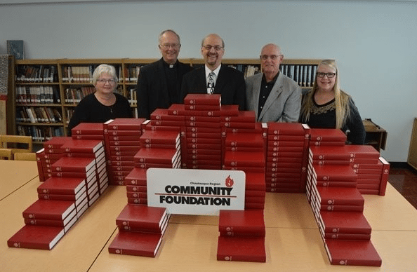 Sharon Westerberg, First Lutheran Church of Jamestown choir member; Pastor Dan Nagle; Brian Bogey, First Lutheran Church of Jamestown minister of music; Greg Jones, Chautauqua Region Community Foundation grants committee member; and Jane Young, First Lutheran Church of Jamestown choir member; pose with the more than 500 new hymnals purchased at First Lutheran Church of Jamestown.