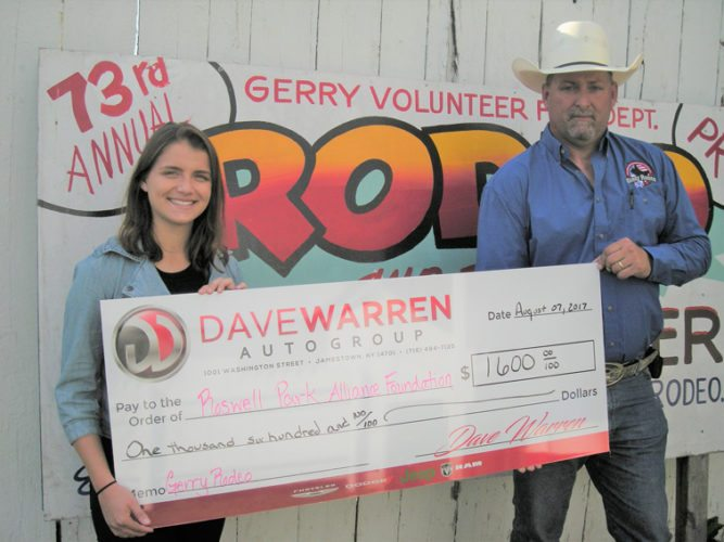 Gerry Rodeo chairman Tom Atwell, right, presents a check to Alexandria Hoaglund, special events coordinator at Roswell Park Cancer Institute, from money raised at this year's rodeo for breast cancer research. Photo by Paul Cooley