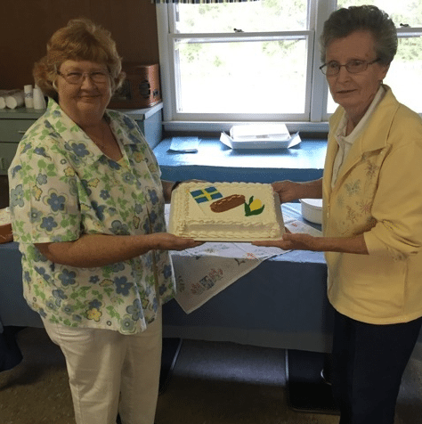 Pictured Susan W. Sipos, Thule Lodge vice chairman, and Diane K. Shaw, lodge chaplain, showing the others the specially decorated cake.