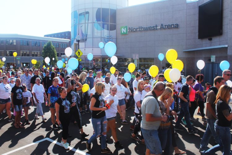 The Out of the Darkness Walk proceeded Saturday morning after a ceremony inside Northwest Arena. Walkers wore shirts as members of teams to remember those who have taken their own lives. Balloons also were carried through the walk to honors those who have died as the result of suicide. P-J photo by Jordan Patterson P-J photo by Jordan Patterson