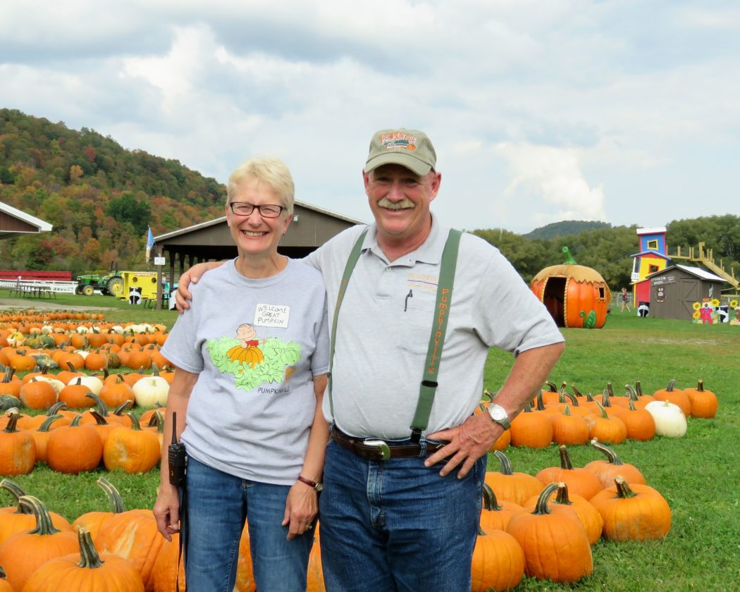 "Dan Pawlowski and his wife, Diane, who own and operate Pumpkinville, invite people to bring their families to experience all the attractions their pumpkin farm has to offer. Below, the resident goats love their new ""Topsy Tervy Goatel,"" a goat hotel of sorts. Photos by Deb Everts"
