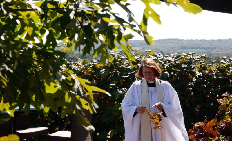 Rev. Virginia Carr blesses the grapes at the fourth annual Blessing of the Grapes in Westfield on Saturday. The event took place at the Grape Discovery Center, along with the Concord Grape Belt Heritage Association's 13th anniversary celebration. Photos by Tonja Dodd