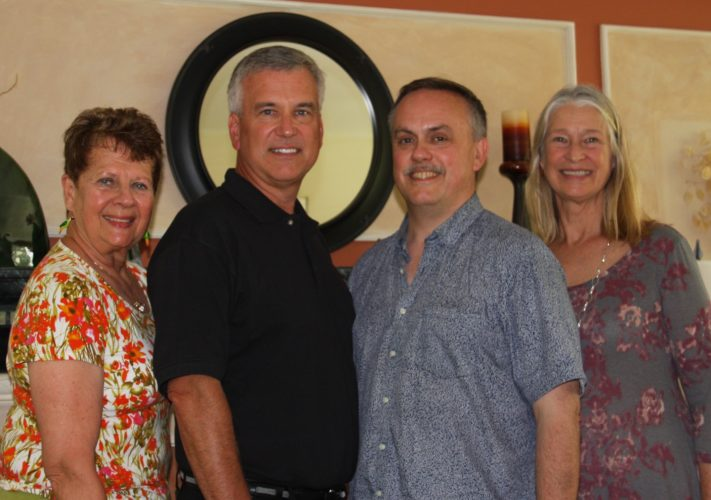 From left are Janita Byars, Community Music Project president; Joe Braeger, Community Music Project general manager; Andy Schmidt, Jamestown Choral Society director; and Rebecca Ryan, Chautauqua Chamber Singers director.